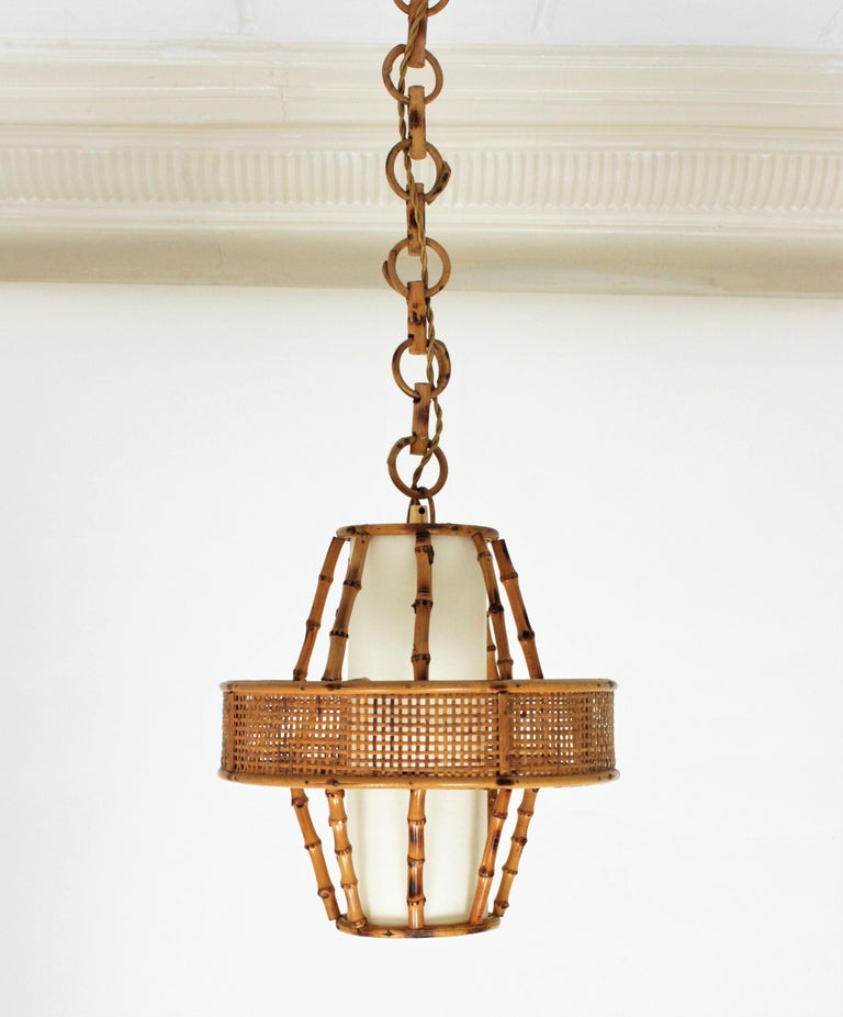 Mid-Century Modern Spanish Modern Wicker Wire, Rattan & Bamboo Conic Pendant Lamp with Tiki Accents For Sale