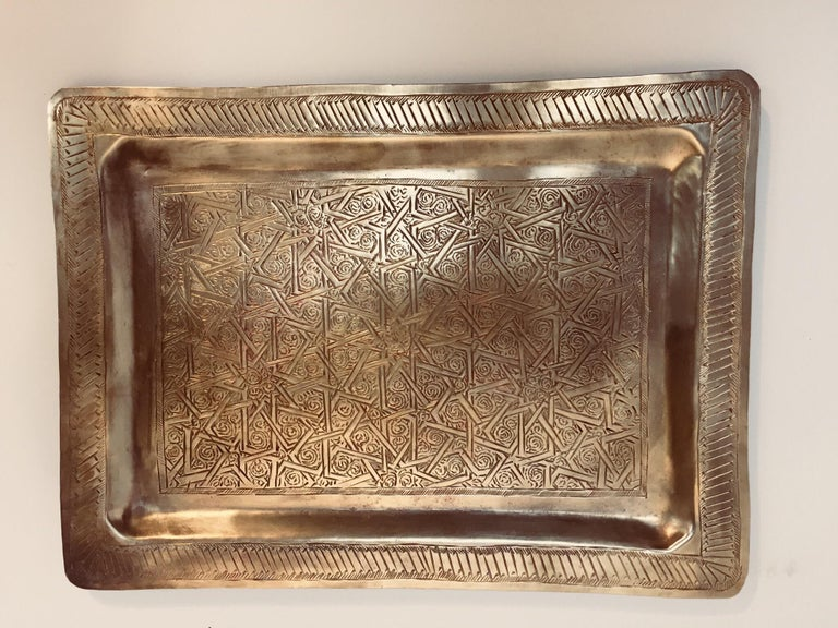 Moroccan Moorish rectangular brass tray with fine delicate geometrical designs. Could be used as a serving tray, or decorative wall hanging. Fine handcrafted hammered and chased Moorish star designs. Hand made in Morocco, circa 1940's.