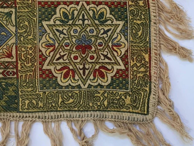 Granada, Islamic Spain, great textile with ivory color fringes featuring Moorish floral and geometric designs with calligraphy Arabic writing. Colors are earth tone in green, blue, ivory and deep Moroccan red. Could be used as a piano shawl, sofa