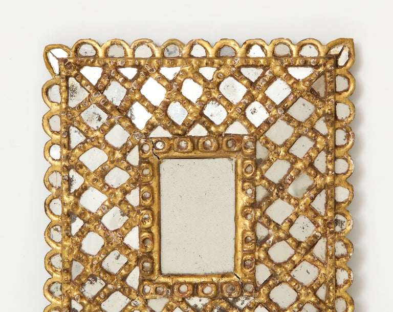 A charming Spanish 1920s petite gilded and carved wood frame with mirrored insets.