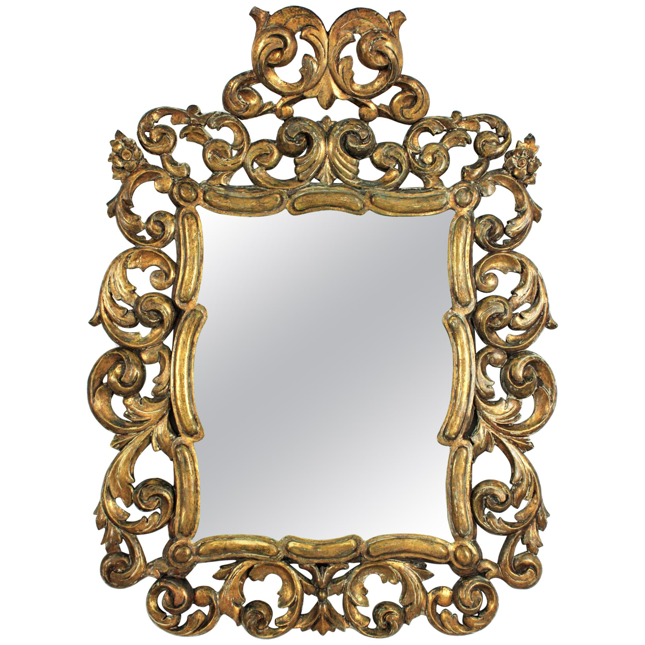 Spanish Rococo Giltwood Mirror with Scrollwork Frame and Crest