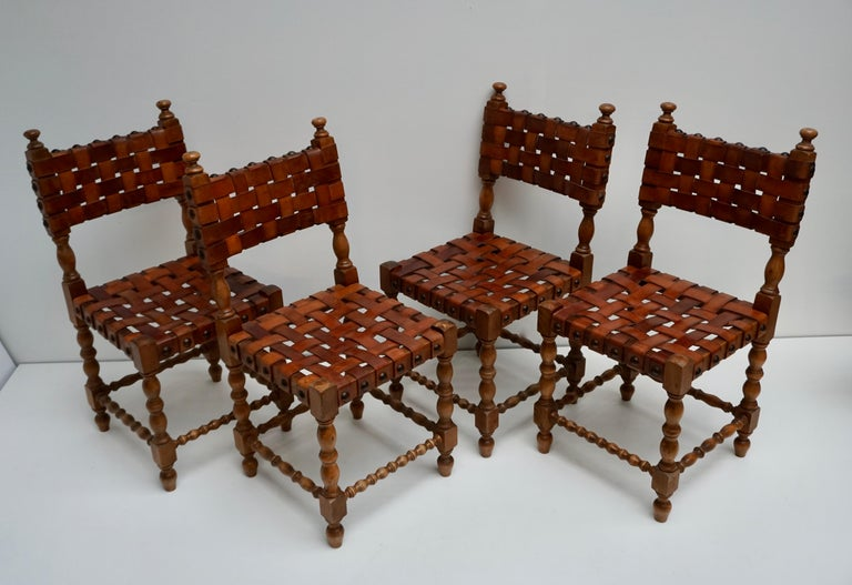 1970s Spanish set of eight interlaced leather wooden chairs.