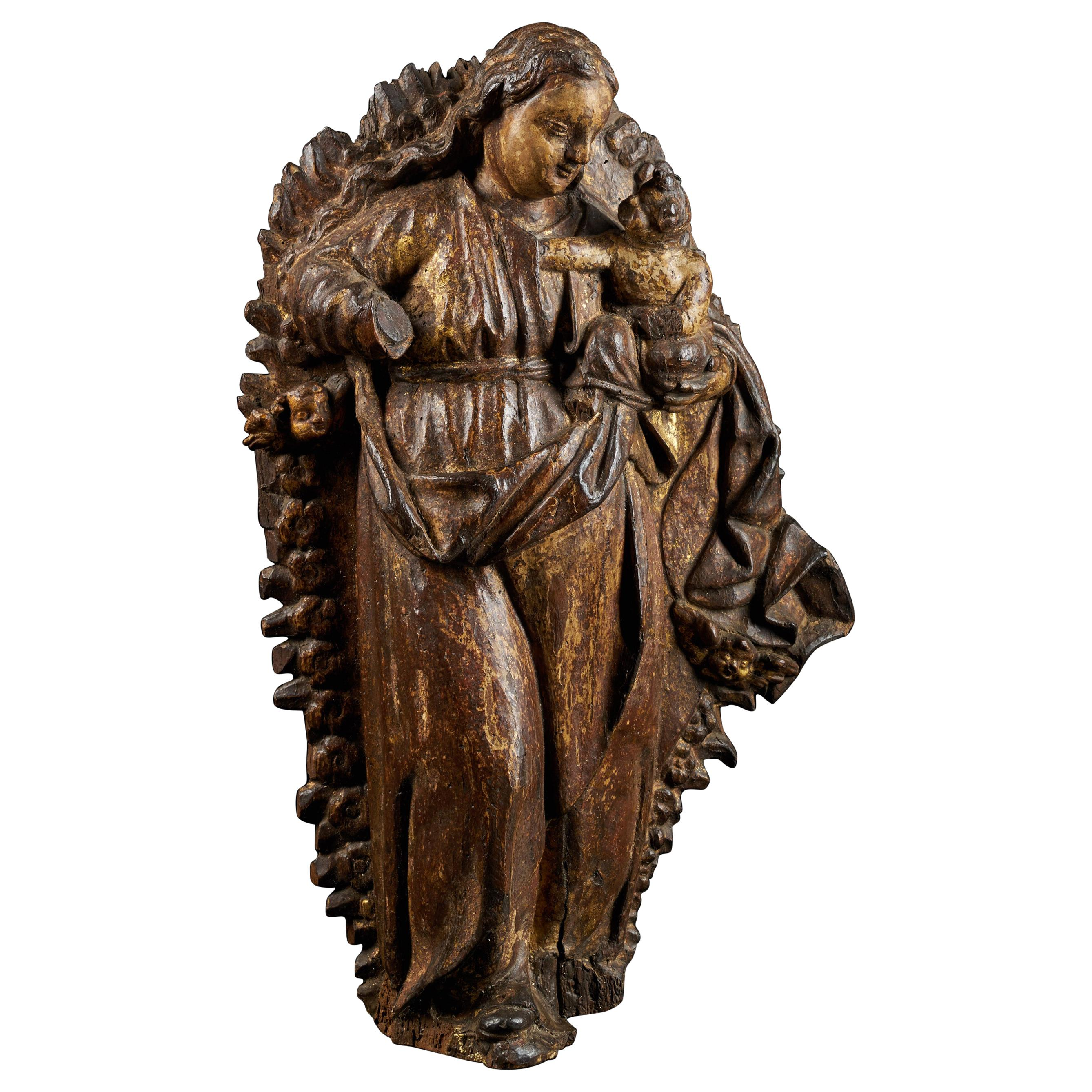 Spanish Shool, Gilded Wooden Relief Sculpture of a Virgin Carrying a Child