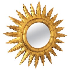 Spanish Sunburst Starburst Mirror in Carved Giltwood, 1950s