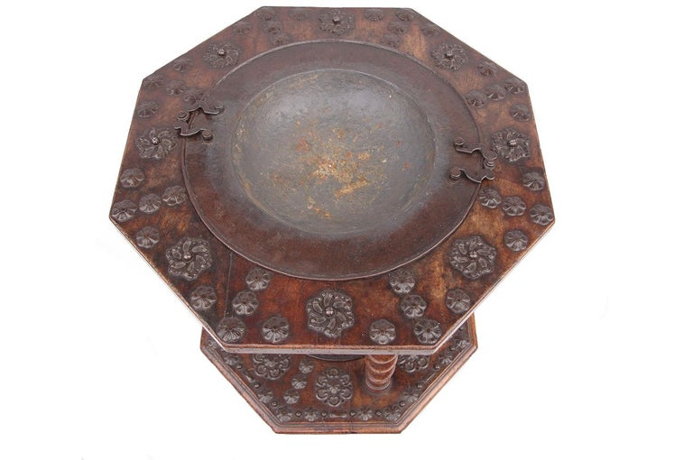 Walnut and metal brazier (or brasero) with two trays and two basins. The upper octagonal tray rests on the lower one thanks to four twisted columns. Trays receive in their center two metal basins surrounding by stylized carved flowers.  The set
