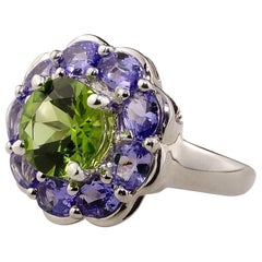 Gemjunky Sparkling Ring of Green Peridot in Tanzanite Halo Sterling Silver