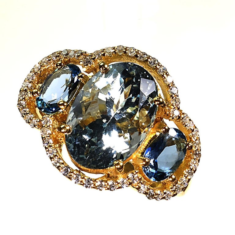 Sparkling Cocktail ring of three Aguamarines with Zircon Halo For Sale 2