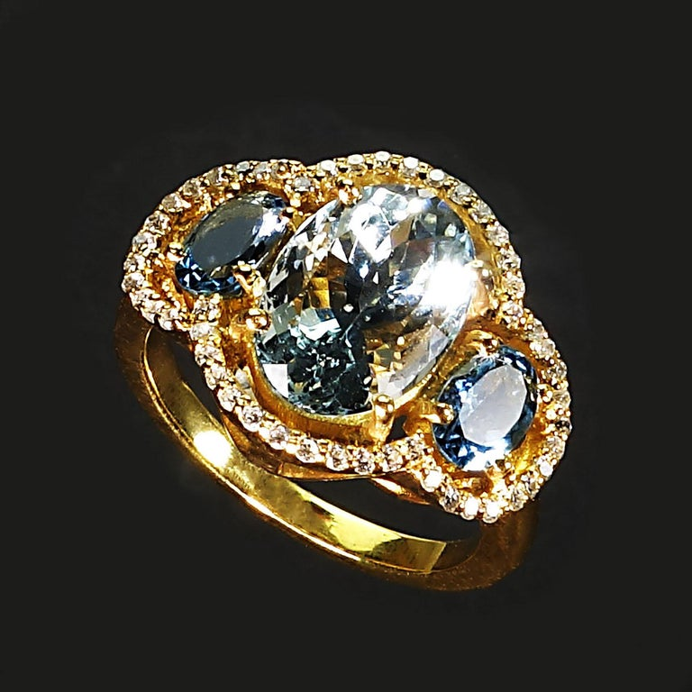 Sparkling Cocktail ring of three Aguamarines with Zircon Halo For Sale 3