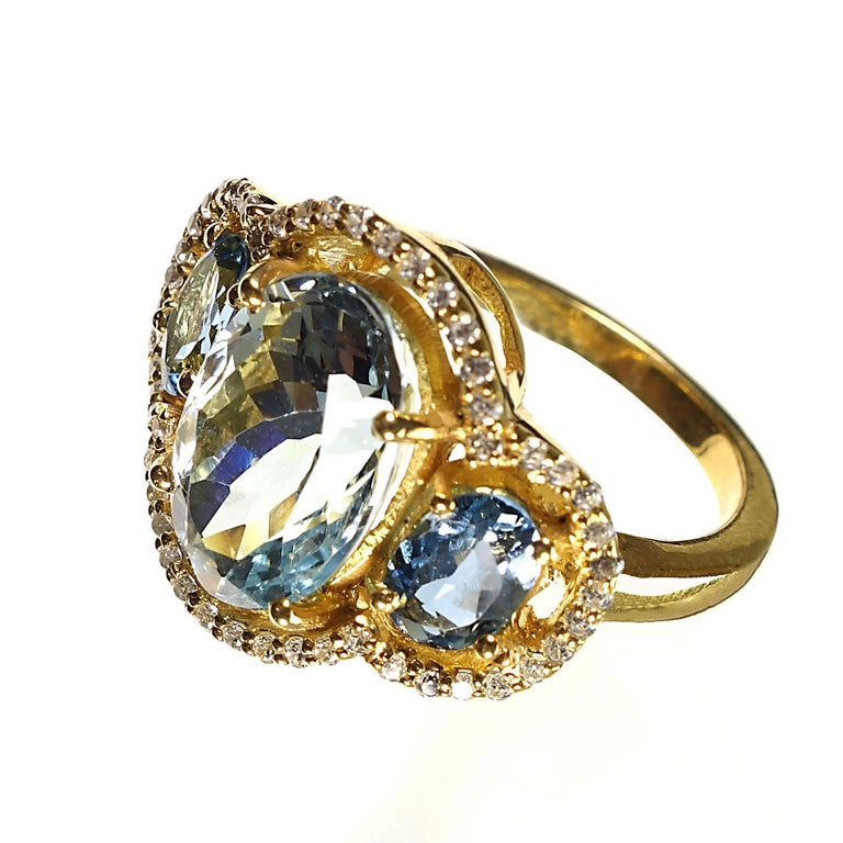 Sparkling Cocktail ring of three Aguamarines with Zircon Halo For Sale 4