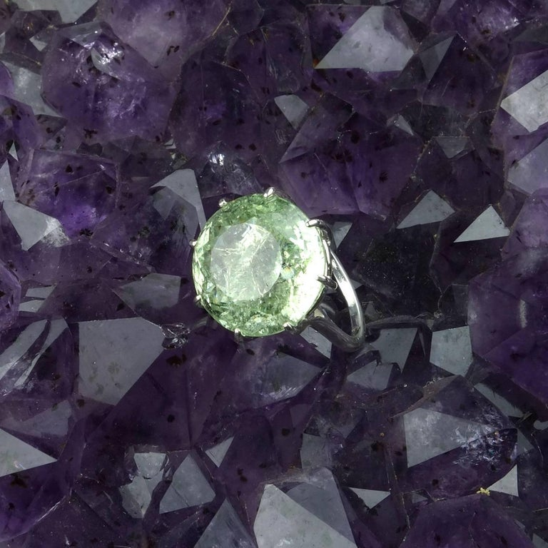 Round green Beryl of 19.50 carats in a sterling silver ring that really makes a statement.  The sparkling stunner has all the natural inclusions common to beryls, which in this case, help to reflect the light back out of the gemstone.  Sizable 8.