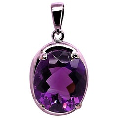 Sparkling Oval Amethyst in Sterling Silver Pendant
