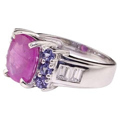Sparkling Pink Sapphire Set in Sterling Silver Ring with Tanzanite Sides