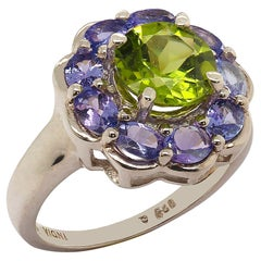 Sparkling Ring of Green Peridot in Tanzanite Halo Sterling Silver