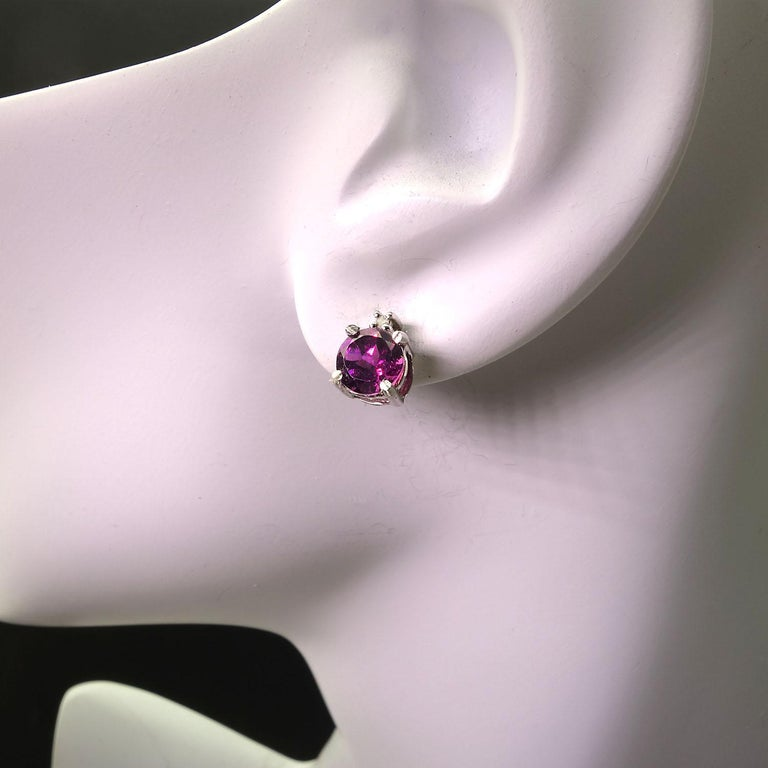 Delightful, glittering, Garnets in 6MM stud earrings with 1 point diamond accents above each garnet.  These sparkling Rhodolite Garnets are a deep purplish pink shade of red in the pyrope family.  The Rhodolite name comes from the Greek 'rhodon' as