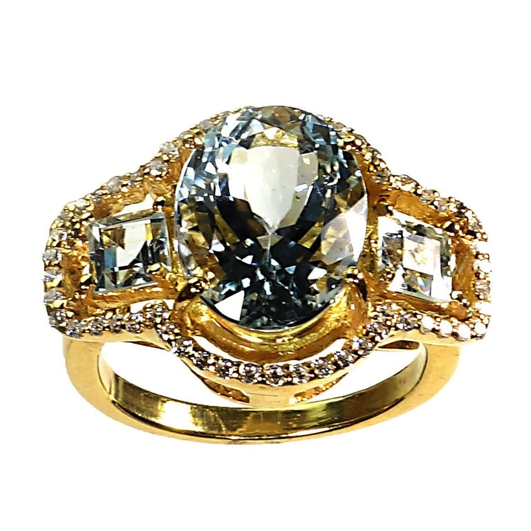 Women's or Men's Sparkling Three stone Aquamarine Dinner ring with Zircons For Sale