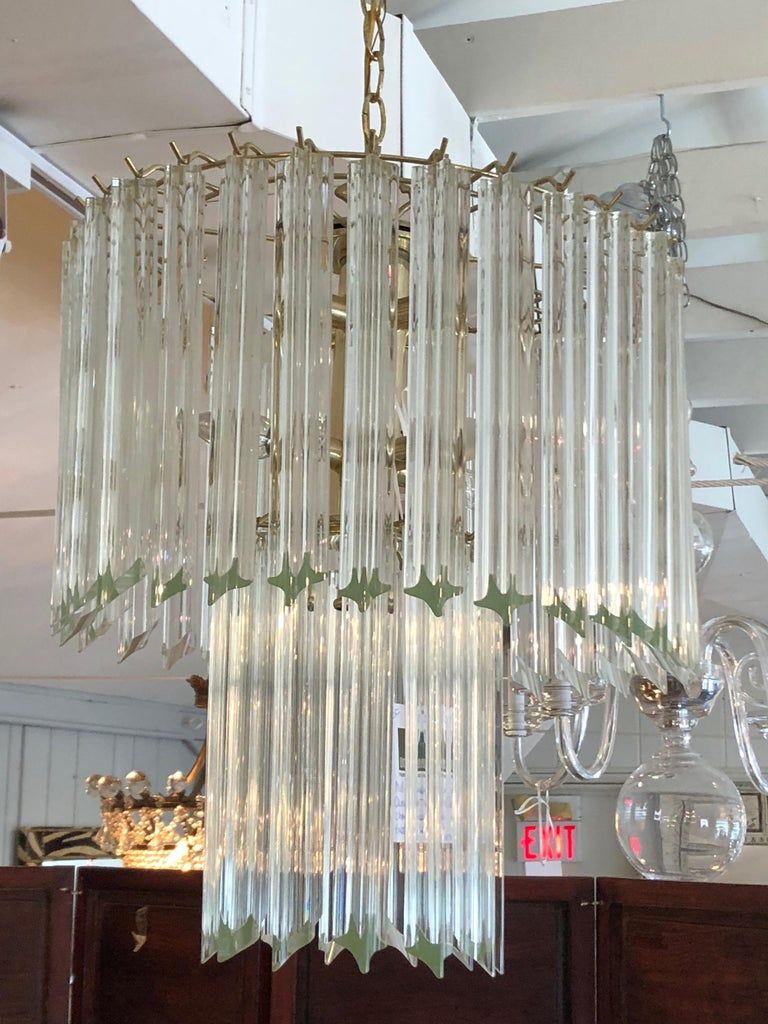 Iconic drippy Venini style chandelier by Camer having multiple chunky sculpted bars of crystal in elongated tiers, 9 sockets in all. Fixture itself is about 22 inches tall.