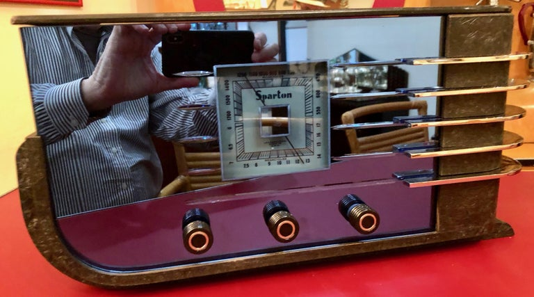 This Sparton Mirrored Radio is a considered to be one of the best examples of Art Deco Streamline Style. Striking Art Deco cobalt blue mirror radio model 557 designed by Walter Dorwin Teague for the Sparks-Worthington Company from Jackson, Michigan