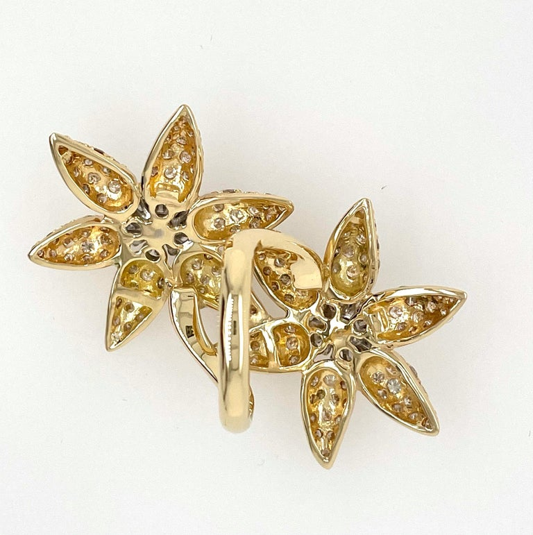 IF you are stylish and fabulous, You NEED this ring!  Double Yellow Gold In-between the fingers flower ring. This stylish flower ring is 1 7/8 inches in length and 2 inches wide at the largest points and has 3.56 carats of white diamonds.  The ring
