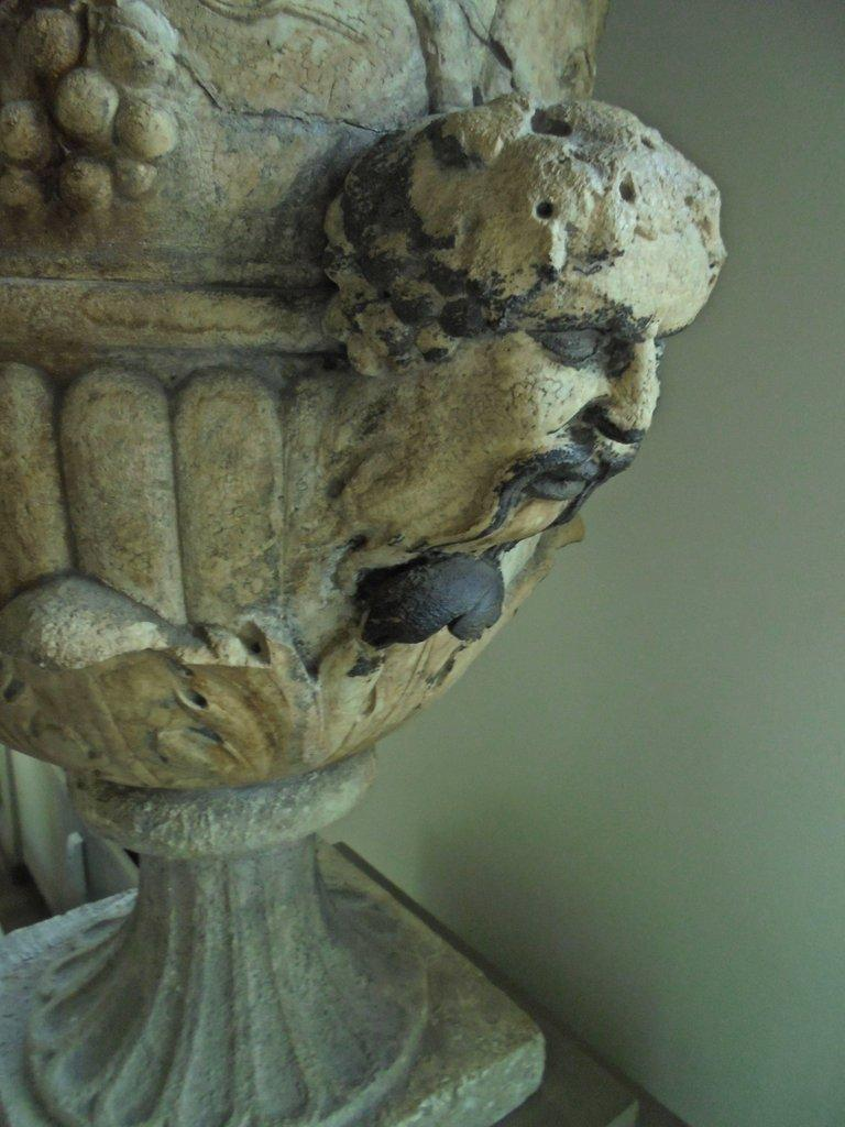Beautifully carved with vines, grapes, Bacchus heads, acanthus leaves on a Gordon base. Fine patina. Mid-18th century. Probably French.
