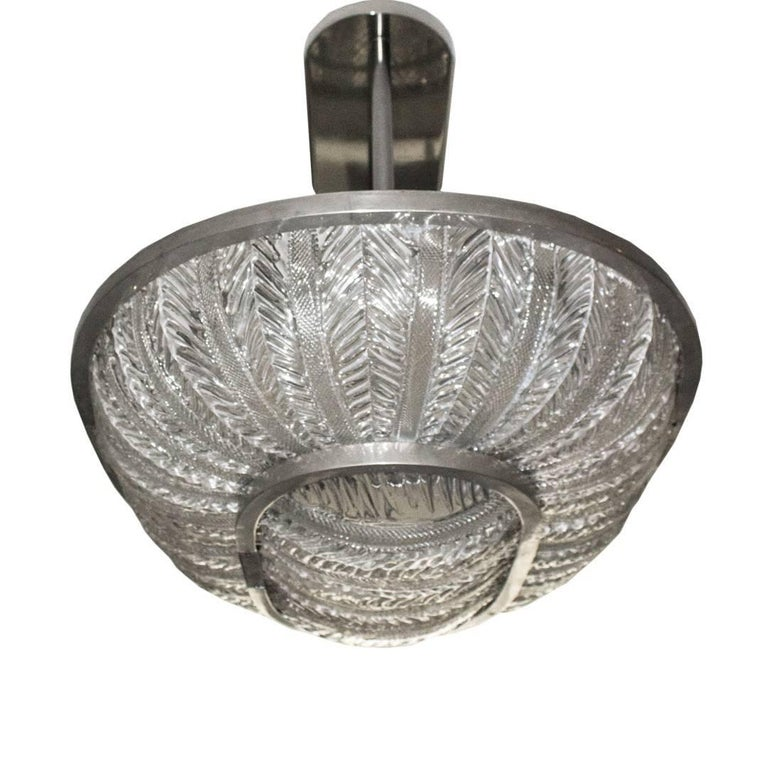 Amazing Barovier & Toso oval plafonnier, circa 1930. This amazing ceiling fixture has two tiers of textured Murano glass panels set into an oval polished nickel frame. This was hanging over the previous owner's kitchen island but could be used over