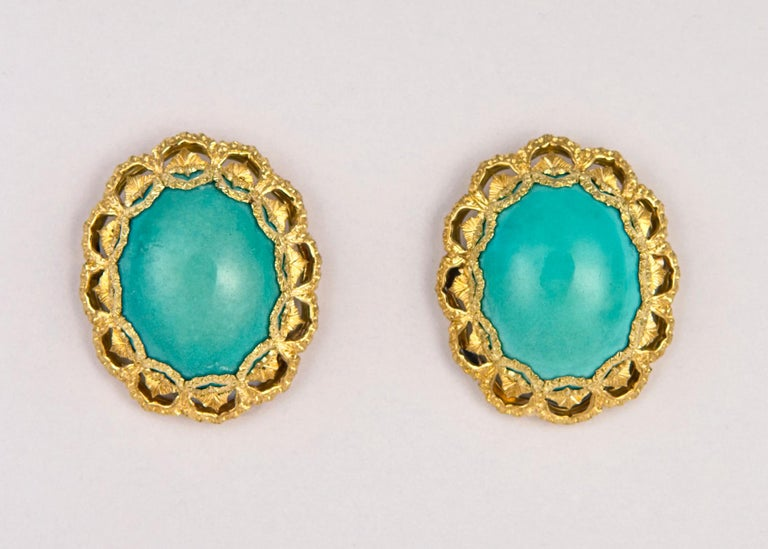 A gorgeous matched pair of turquoise are elegantly framed with the detailing and engraving Buccellati is famous for. Just over 1 inch in size. Classic elegance !!!