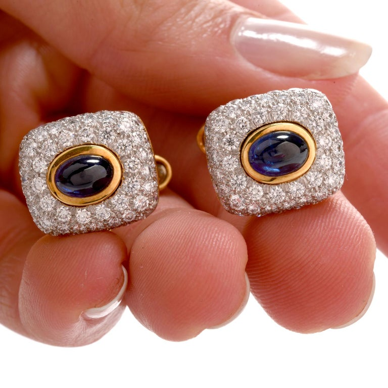 This Spectacular pair of Cufflinks boasts of Style for the gentleman wearing them.  Featuring an oval cabochon cut Sapphire in each measuring appx. 4.3 x 6.44,  bright white pave set Diamonds cover the remaining surface of these 18K and Platinum