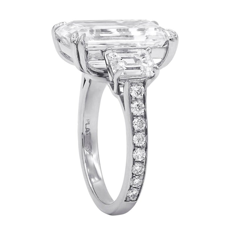 Spectacular Emerald Cut Diamond Ring. The center diamond is 9.38 Carats, The Color grade is I, the Clarity is VVS2. The center stone measures 15.63x10.19x6.32 mm. Accompanied with GIA Certificate.  The center diamond surrounded by Two Emerald cut