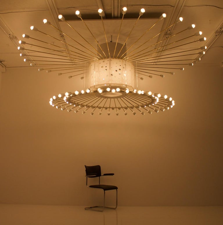 """Extraordinary and very large impressive """"Sputnik ceiling lamp"""" from the 1950s.  Built to order for a large ballroom in Frankfurt, Germany. 132 sockets for E27 light bulbs. 108 light bulbs are used in the sockets on the rings, 24 light bulbs in the"""