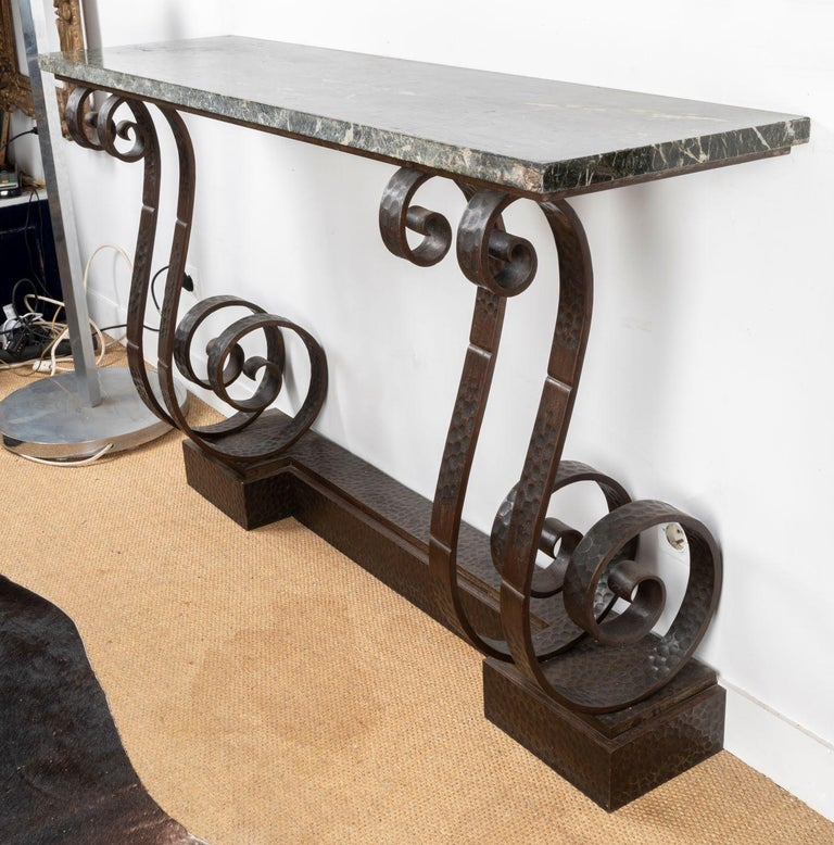Spectacular Hammered Wroughtiron Art Deco Console Table, attributed to Edgard Brandt (1880 - 1960) , France 1930's with dark grey marble top  It was in 1902 that Edgard Brandt created in Paris, at 76, rue Michel-Ange, the Brandt establishments