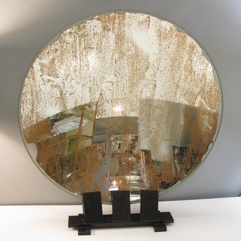 Rare large lighthouse mirrored optic lens sculpture mounted on custom made pedestal. Huge Industrial concave mirror used in lighthouse in France in the early 20th century. Solid brass with aged patina custom made base. This interesting piece