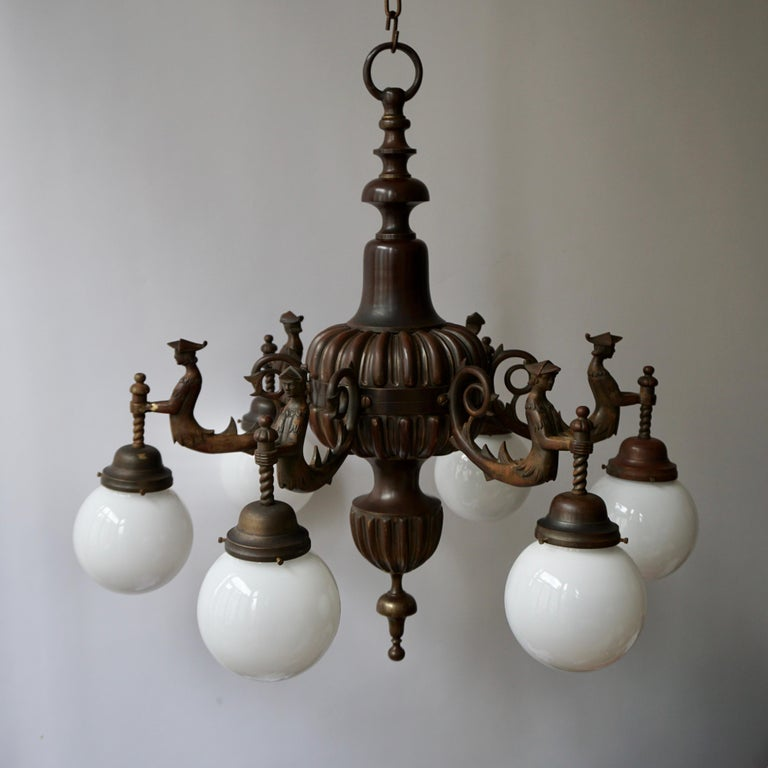 A spectacular and large Italian patinated bronze multi light figural chandelier.