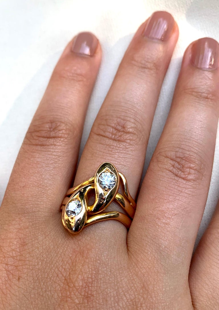 Beautiful antique double serpent diamond and gold ring, late 19th century, the two snakes intricately coiled to form an impactful 22mm ring. The two old European cut diamonds dazzling bright and measuring .75 carat total weight, both stones with an