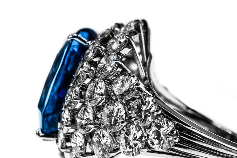 Spectacular Massive Sapphire and Diamond Ring, France Centering one cushion-shaped sapphire approximately 46.31 cts., surrounded and flanked by 48 round diamonds approximately 11.80 cts., with makers mark and French assay mark, approximately 18