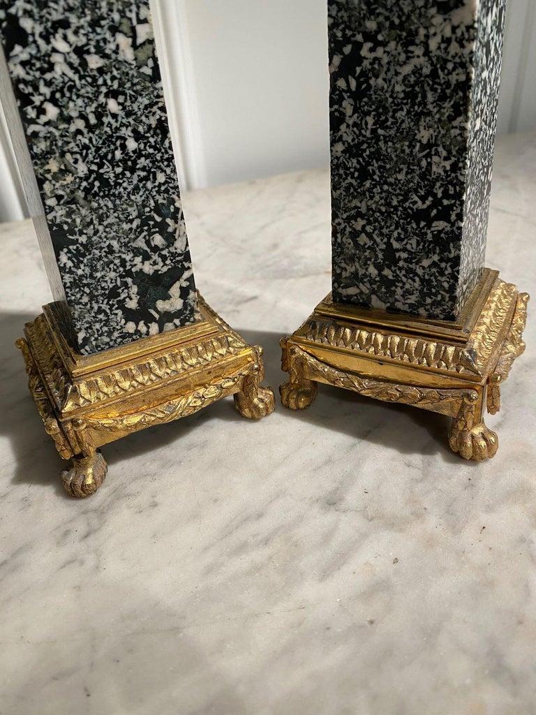 Pair of Italian Ormolu-mounted green granite obelisks on gilt bronze bases  France, Louis XVI period, late 18th century  Granito verde della antico (Ophytes) – Egyptian antic green granite  Dimensions :   H. 36 cm – W. 8 cm – D. 8 cm ( 14
