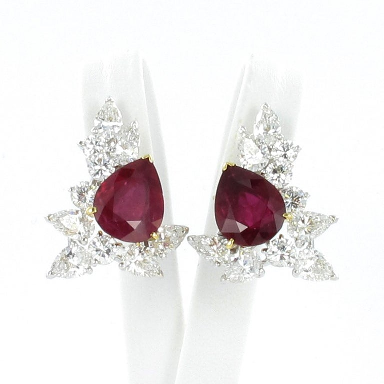 Magnificent pair of ruby and diamond ear clips by Paris based French Jeweller FRED.  Each set with a very fine pear-shaped ruby weighing 3.79 and 4.25 carats respectively. The rubies are accompanied by Gubelin Gem Lab Report quoting Thai origin with
