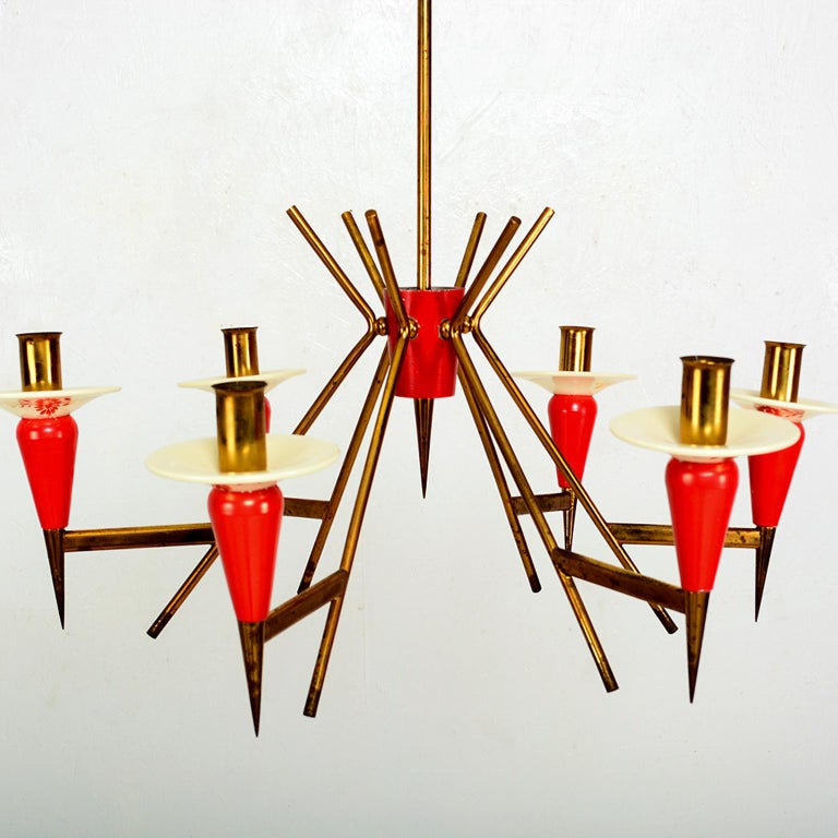 For your consideration: STILNOVO Sputnik Six Arm Chandelier in Vivid Red. Original vintage condition. Chandelier has been rewired. Patinated brass body, red painted aluminum shades, glazed ceramic.  Made in Italy, circa the 1950s. No label, atomic