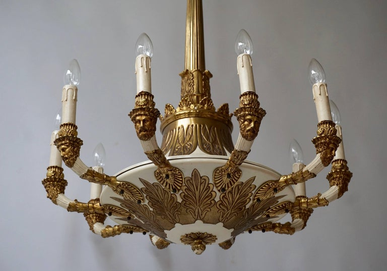 Spectacular Ten Arms Brass White Painted Chandelier with Men's Head In Good Condition For Sale In Antwerp, BE