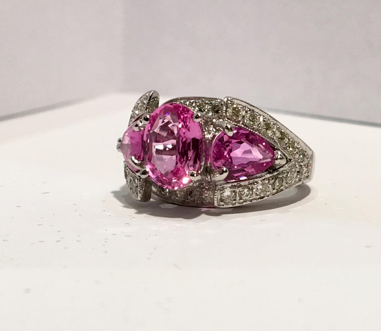 Spectacular Vivid Pink Sapphire Diamond Platinum Three-Stone Ring In New Condition For Sale In Tustin, CA