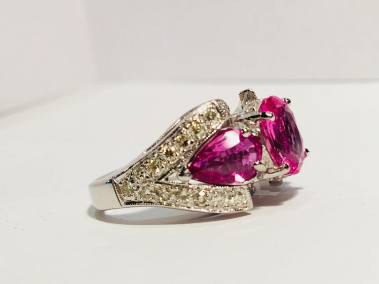 Spectacular Vivid Pink Sapphire Diamond Platinum Three-Stone Ring For Sale 2