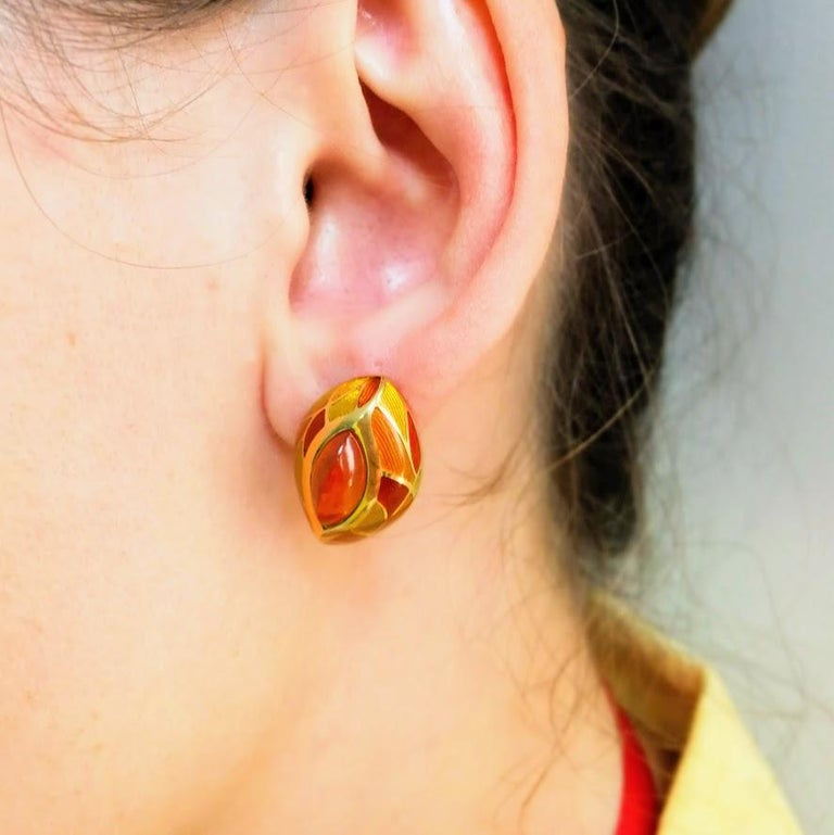 Spessartine Garnet 6.40 Carat, Enamel 18K Yellow Gold Earrings  A riot of yellow and orange colors, warm of citrus tea on a rainy autumn day, a smoldering log in the fireplace of a country house, all of this is our stunning Earrings. Take a look at