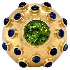 Georg Spreng - Sphere Ball Ring 18K Yellow Gold Green Peridot 16 Blue Sapphires