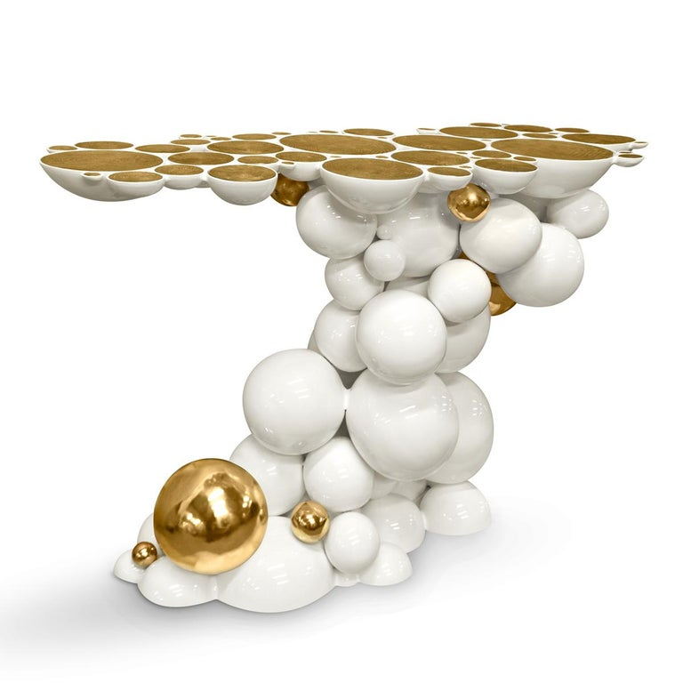 Console table spheres composed by metallic spheres and semi spheres joined together. Aluminium white varnish and gold finish. Also available in Black finish.