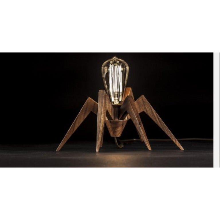 Spider lamp by Alexandre Caldas Dimensions: W 30 x D 23 x H 14 cm Materials: Solid walnut wood  Materials available in ash, beech, walnut  Spider lamp is a decorative light in solid wood, with the capacity to be used according to the