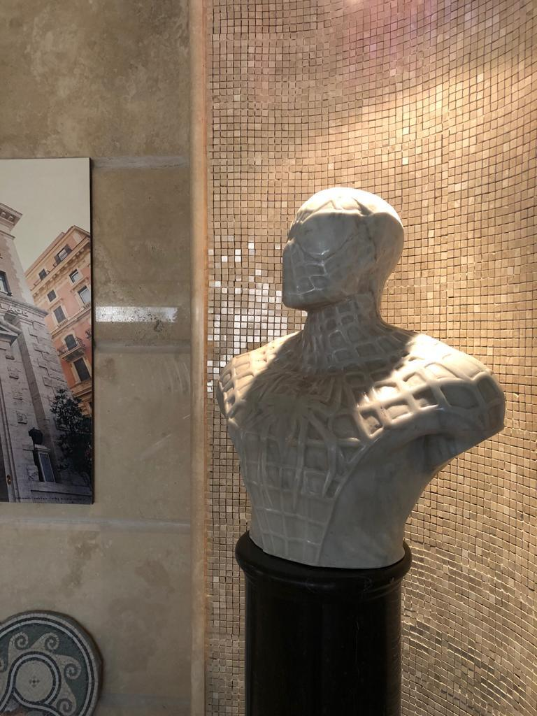 The sculpture was made from a single block of Carrara statuary marble, one of a kind piece.