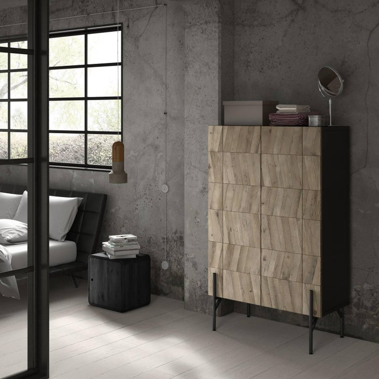 Getting its name from the elegant herringbone pattern that graces its two front panels (