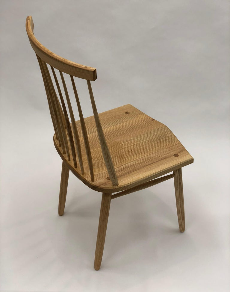 In designing this chair I wanted to best utilize the best and most practical aspects of the classical Windsor chair and apply them in contemporary proportion. The genius of the classical Windsor is in its efficient construction, every part is