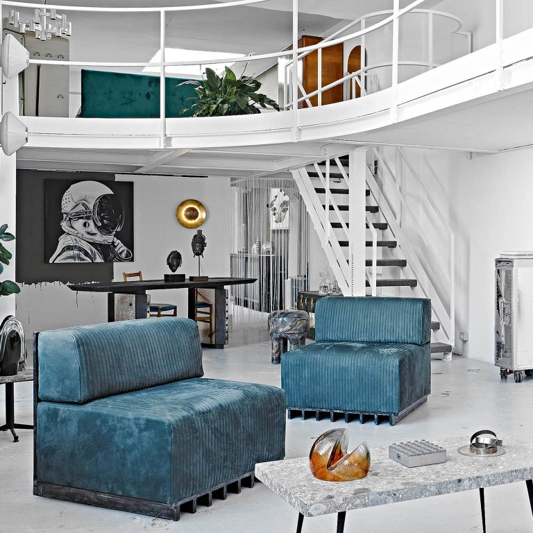 Lamè (sofa) Technical and tactile like an air-cooled engine, Lamè melts the hardware world of engines mechanics with the softness of a seat. The foamy grey leather welcomes you to chill-out while the materic structure gives to the piece a sense of