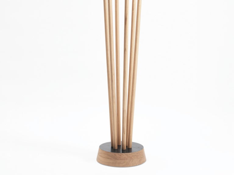 Strongly anchored in a solid wood base, offering different levels, the 6 masts of the Spirale coat rack create an elegant and quirky figure. More than just a coat rack it is a decorative sculpture for an entrance, a hall. The color of the base can