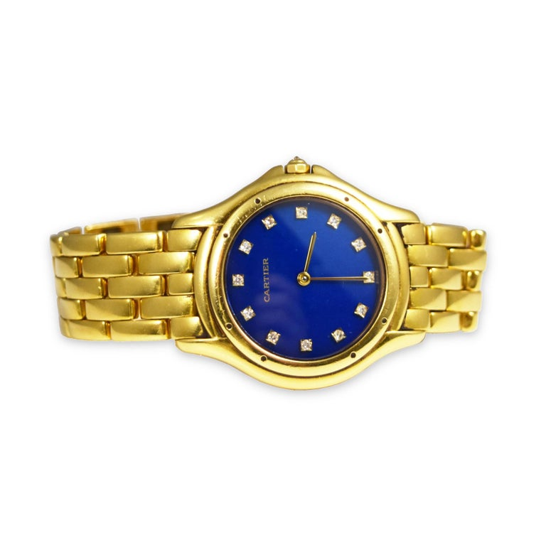 This lovely watch by Cartier features a contemporary, yet classic design with its round case in 18k yellow gold, an interesting variation of the best-seller Panthere watch. It is luxuriously adorned by diamonds on its stunning marine blue dial