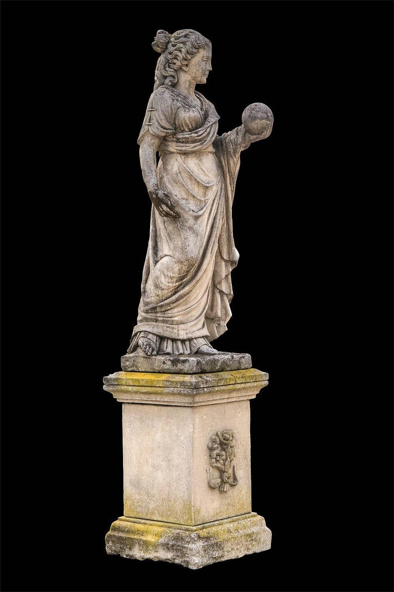 This is a figure of Urania, a Muse, sometimes associated with Astronomy; she holds a celestial orb.  As a vestal with the Greek drapery throughout the body and the left hand keeping the world, representing the science and knowledge on a quadrangular